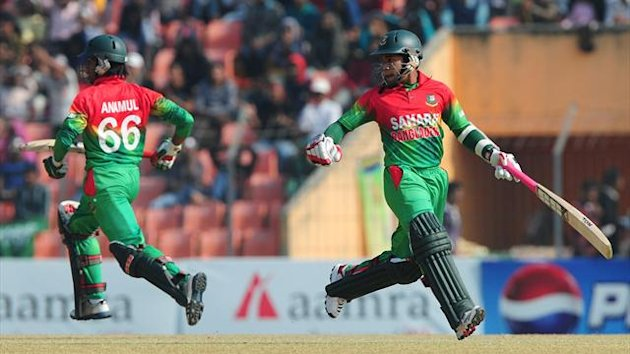 Bangladesh cricket captain Mushfiqur Rahim (R) run between the wickets with his teammate Anamul Haque (L) during the second one day international cricket match between Bangladesh and the West Indies at the Sheikh Abu Naser Stadium in Khulna