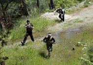 Syrian rebels from the Al-Ezz bin Abdul Salam Brigade take part in a training session near Jabal Turkmen in Syria's northern Latakia province on April 24, 2013