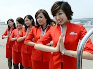 Air Asia Japan's cabin attendants at Narita International Airport on July 19, 2012. All Air Asia Japan staff will become Vanilla Air staff