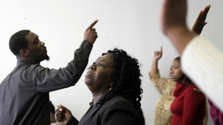 Members of the Coney Island Cathedral of Deliverance worship in a neighboring community center, Sunday, Nov. 4, 2012, in New York after their church and beach community were heavily damaged by Superstorm Sandy. (AP Photo/Mark Lennihan)