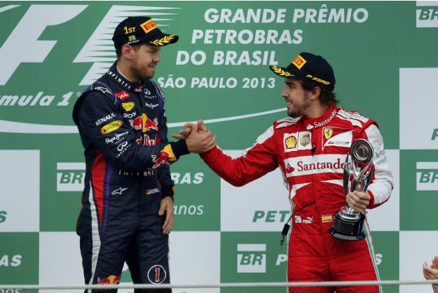 Fernando Alonso of Spain and Sebastian Vettel of Germany congratulate each other on the podium after the Brazilian F1 Grand Prix at the Interlagos circuit in Sao Paulo