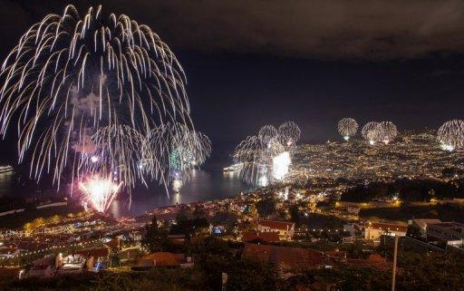 Fireworks light up the sky above Funchal Bay, Madeira Island, to celebrate the New Year on January 1, 2013