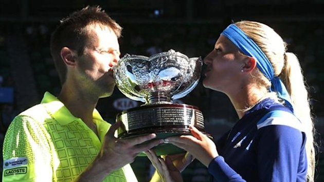 Kristina Mladenovic of France and Daniel Nestor of Canada pose with the trophy after defeating Horia Tecau of Romania and Sania Mirza of India in their Mixed Doubles final match at the Australian Open (Reuters)