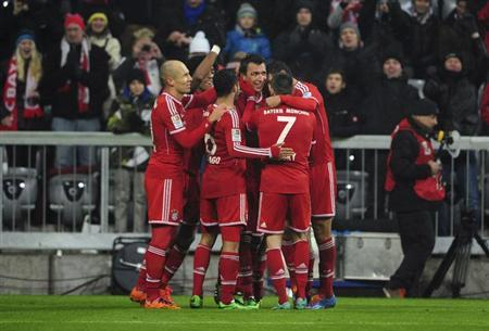 Bayern Munich's players celebrate a goal against Eintracht Frankfurt during the German first division Bundesliga soccer match in Munich February 2, 2014. REUTERS/Lukas Barth