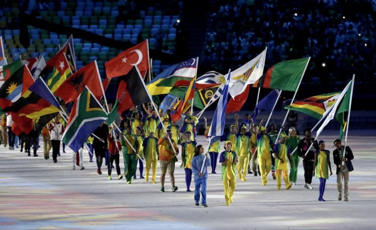 Dozens of countries, including Afghanistan (pictured), had volunteers carrying their flags at the Closing Ceremony Sunday night. (Getty)