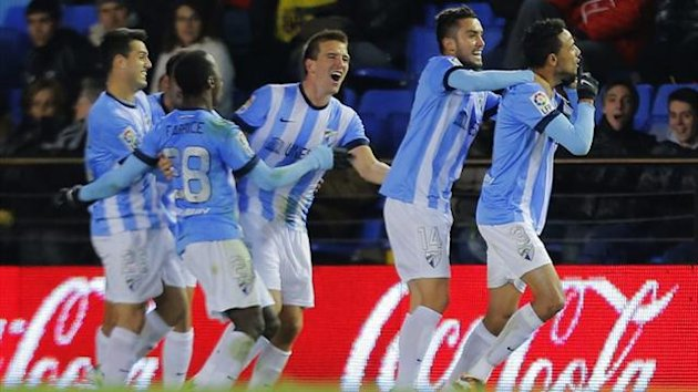 Malaga players celebrate (AFP)