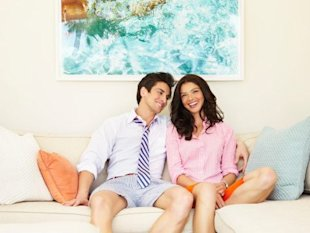 Couple smiling on couch together