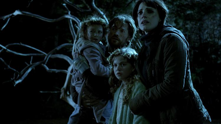 "This film image released by Universal Pictures shows, from left, Isabelle Nélisse, Nikolaj Coster-Waldau, Megan Charpentier and Jessica Chastain in a scene from ""Mama."" (AP Photo/Universal Pictures)"