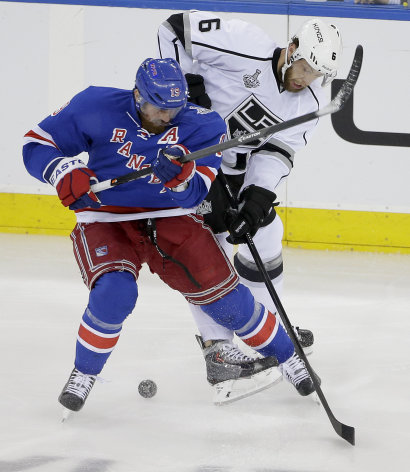 New York Rangers center Brad Richards (19) vies for the puck against Los Angeles Kings defenseman Jake Muzzin (6) in the first period during Game 4 of...