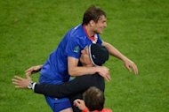 Croatian forward Nikica Jelavic (L) celebrates with his head coach Slaven Bilic after scoring a goal during the Euro 2012 football championships match Ireland vs Croatia at the Municipal Stadium in Poznan