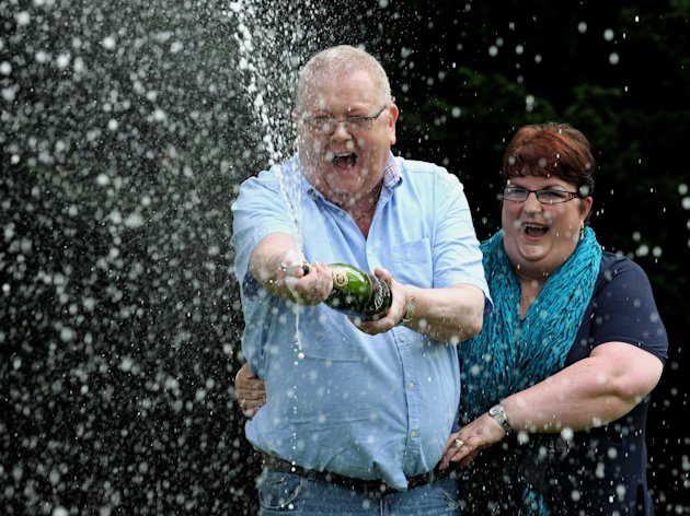 Colin and Christine Weir, from Largs in Ayrshire, celebrate their £161million EuroMillions win.