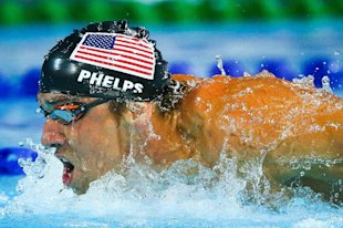 Michael Phelps competes at the Pan Pacific Championships in Australia on August 24, 2014 (AFP Photo/Michael Hamilton)