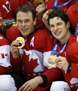 Canada forwards Jonathan Towes, left, and Sidney Crosby, right, pose with their medals after beating Sweden 3-0 in the men's ice hockey gold medal game at the 2014 Winter Olympics, Sunday, Feb. 23, 2014, in Sochi, Russia. (AP Photo/Mark Humphrey)