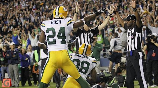 Seattle Seahawks wide receiver Golden Tate (bottom, obscured) catches the 14-12, game-winning touchdown in the endzone while he is swarmed by Green Bay Packers' Jarrett Bush (24) and Tramon Williams (Reuters)