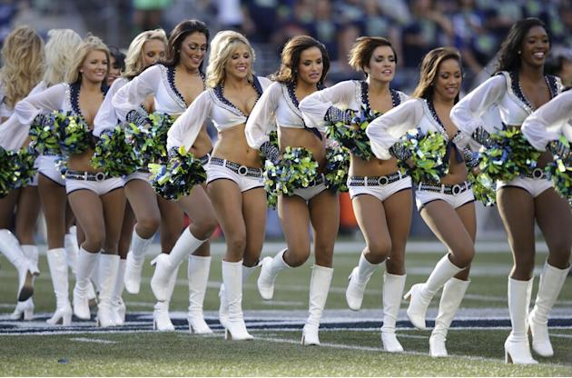 Seattle Seahawks Sea Gals cheerleaders perform in the first half of an NFL football game between the Seattle Seahawks and the Green Bay Packers, Thursday, Sept. 4, 2014, in Seattle. (AP Photo/Stephen