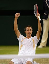 Czech Republic's Lukas Rosol celebrates his victory in his second round men's singles match against Spain's Rafael Nadal on day four of the 2012 Wimbledon Championships tennis tournament at the All England Tennis Club in Wimbledon, southwest London