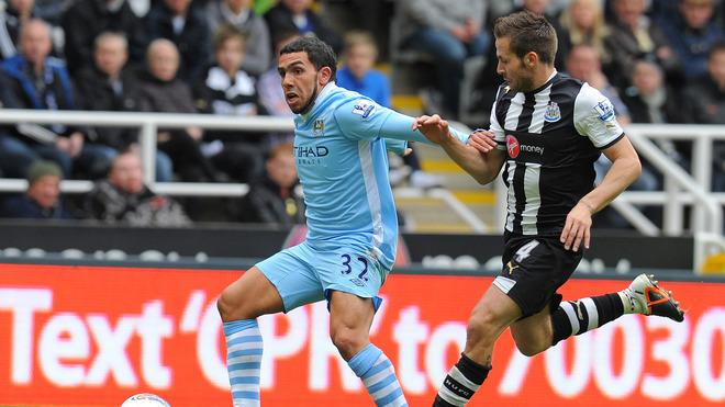 Newcastle United's French Midfielder Yohan Cabaye (R) Vies With Manchester City's Argentinian Striker Carlos Tevez    AFP/Getty Images