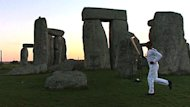 Legendary American athlete Michael Johnson carried the Olympic flame through Stonehenge on Thursday, as dawn broke over the ancient, mystic monument