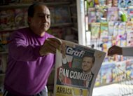 A man sells a newspaper with information on the new Mexican president for the Institutional Revolutionary Party (PRI), Enrique Pena Nieto. Pena Nieto delivered a stunning return to power for Mexico's once-reviled PRI party, but the president-elect faces a stiff challenge in cutting poverty and clamping down on rampant drug violence