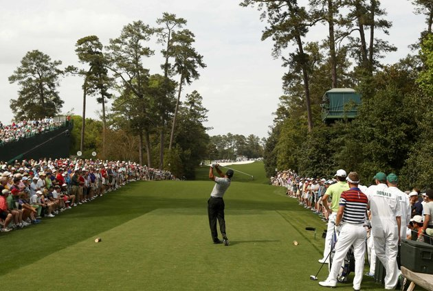 Tiger Woods of the U.S. hits his tee shot on the 18th hole during first round play in the 2013 Masters golf tournament in Augusta