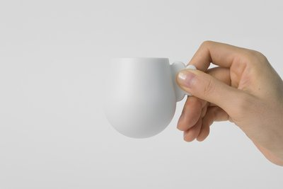 Espresso cup with a cloud shape handle