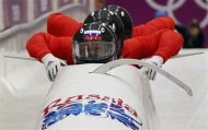 Russia's pilot Alexander Zubkov (front) and his teammates start during a four-man bobsleigh training event at the Sanki Sliding Center in Rosa Khutor, during the Sochi 2014 Winter Olympics February 19, 2014. REUTERS/Alister Doyle