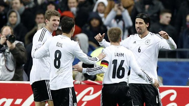 Germany's Sami Khedira (R) celebrates with team mates Thomas Muller (L), Mesut Oezil (2ndL) and Philipp Lahm (2ndR) after scoring a goal against France during their international friendly soccer match at the Stade de France stadium (Reuters)
