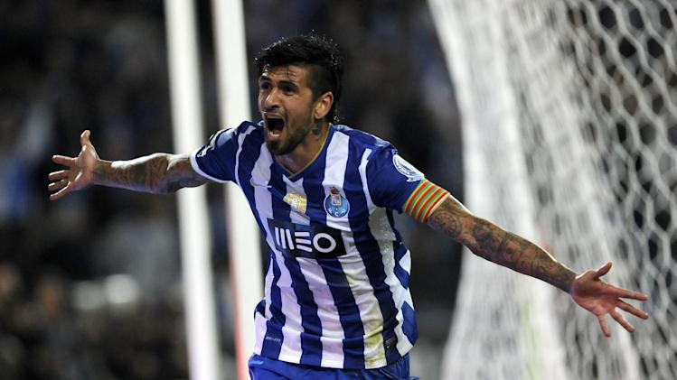 FC Porto's Lucho Gonzalez, from Argentina, celebrates after scoring his side's third goal against Sporting in a Portuguese League soccer match at the Dragao stadium in Porto, Portugal, Sunday, Oct. 27, 2013. Lucho scored once in Porto's 3-1 victory and the club stands on the top of the league