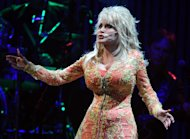 "KNOXVILLE, TN - JULY 17: Singer/Songwriter Dolly Parton performs during the ""Better Day"" world tour opener at the Thompson-Boling Arena on July 17, 2011 in Knoxville, Tennessee. (Photo by Rick Diamond/Getty Images)"