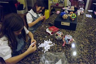 Isabelle and Katherine Adams With Origami