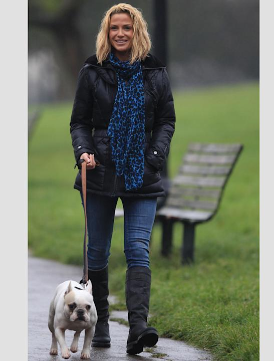 Celebrity pets: Sarah Harding puts in some exercise with her pooch and she looks pretty pleased to have him for company!