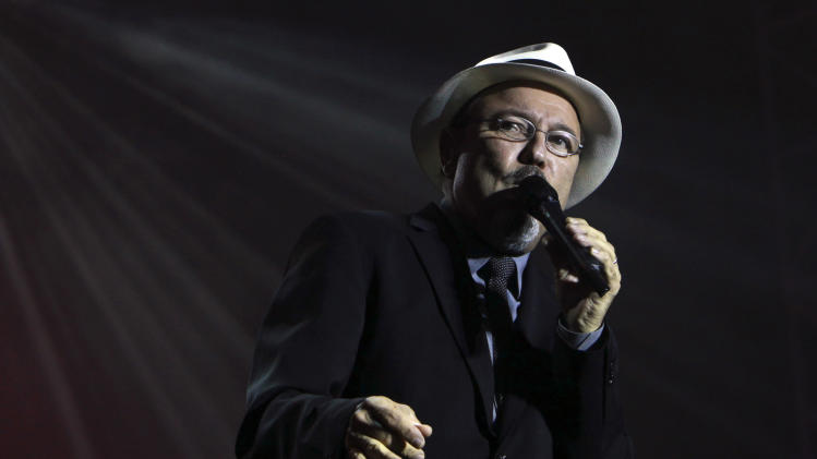 "FILE - In this April 16, 2010 file photo, Panama's Ruben Blades sings in concert during his ""Todos Vuelven"" tour in Quito, Ecuador. Blades will join the cast of the film ""Manos de Piedra,"" by Venezuelan director Jonathan Jakubowicz, playing the role of boxing businessman Carlos Eleta. The film tells the story of Panamanian boxer Roberto Duran. (AP Photo/Dolores Ochoa, File)"