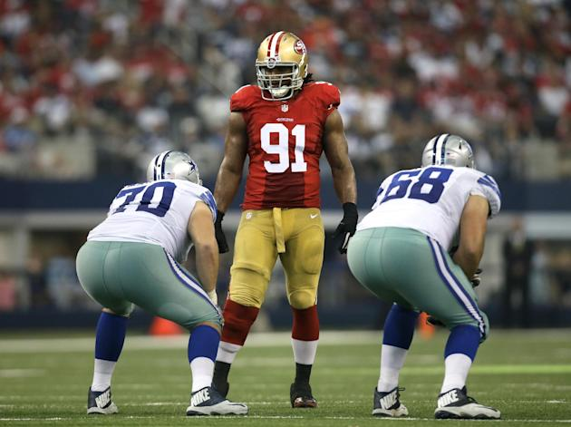 San Francisco 49ers defensive end Ray McDonald (91) stands at the line of scrimmage over Dallas Cowboys' Zack Martin (70) and Doug Free (68) during the second half of an NFL football game, Sunday, Sep
