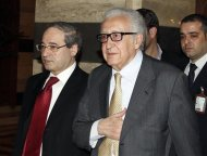 United Nations Envoy Lakhdar Brahimi (C) returns to a hotel after meeting Syria's President Bashar al-Assad in the Syrian capital Damascus October 30, 2013. REUTERS/Khaled al-Hariri