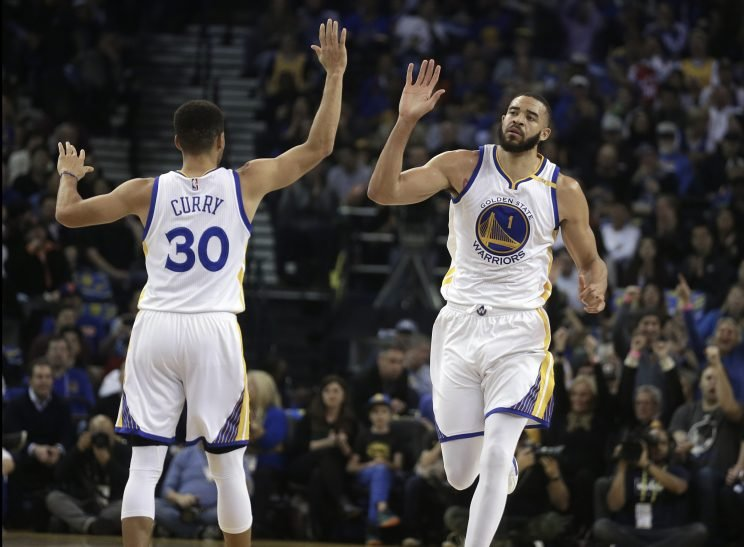 Stephen Curry and JaVale McGee celebrate success. (Associated Press)