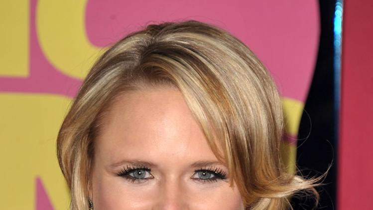 FILE - In this June 6, 2012 file photo, Miranda Lambert arrives at the 2012 CMT Music Awards in Nashville, Tenn. Brad Paisley and Carrie Underwood co-host the CMA awards show on Thursday, Nov. 1, 2012, at 8 p.m. EDT, live on ABC from the Bridgestone Arena in Nashville. When country music's biggest stars take the stage tonight, you'll see many of your favorites from the last 10 years, though increasingly, new faces are dominating the genre as country's fan base shifts to a younger-skewing audience. (Photo by John Shearer/Invision/AP, File)