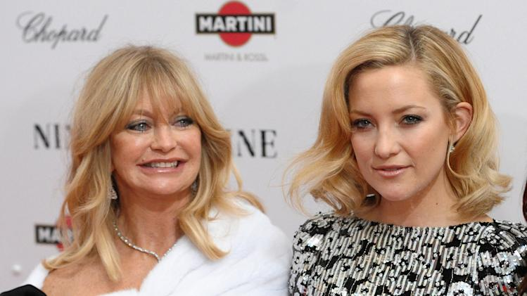 "FILE - This Dec. 15, 2009 file photo shows actress Goldie Hawn, left, and her daughter Kate Hudson at the premiere of ""Nine"" at the Ziegfeld Theatre in New York. When Kate Hudson first burst onto the scene with the movie ""Almost Famous,"" her uncanny resemblance to her mother Goldie Hawn had everybody talking. Hudson didn't see it. But now that she's a mother herself, the 34-year-old actress says she treasures the comparison. The mother-daughter pair has never acted together, but they teamed up for an Almay ad for Mother's Day.  (AP Photo/Peter Kramer, file)"