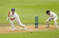 England captain Alastair Cook bats against New Zealand in Dunedin on March 9, 2013. A double century stand by Cook and Nick Compton pulled England off the ropes and into a relatively safe position in the first Test