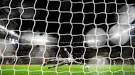 Olympiakos FC's goalkeeper Balazs Megyeri dives to try and save a shot from Arsenal's Gervinho during their UEFA Champions League Group B match at the Emirates Stadium in London. Arsenal won 3-1