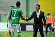 Saint-Etienne's Gabonese forward Pierre-Eme Aubameyang (L) shakes hands with Saint-Etienne's French coach Christophe Galtier during the French L1 football match Saint-Etienne vs Nancy on October 5, at the Geoffroy-Guichard stadium in Saint-Etienne, central France