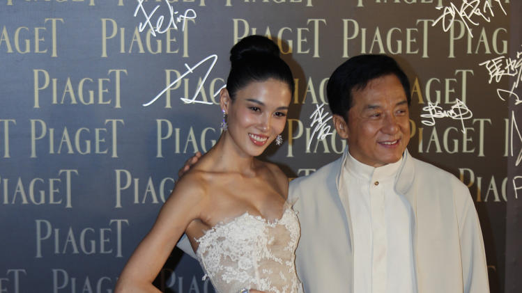 Chinese actress Zhang Lanxin poses with Hong Kong actor Jackie Chan for photographers on the red carpet of the 32nd Hong Kong Film Awards in Hong Kong  Saturday, April 13, 2013. (AP Photo/Vincent Yu)