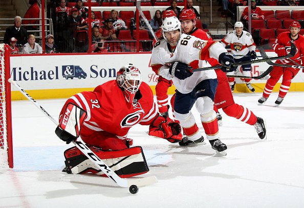 RALEIGH, NC - NOVEMBER 27: Michael Leighton #32 of the Carolina Hurricanes deflects the puck away from Jaromir Jagr #68 of the Florida Panthers during an NHL game on November 27, 2016 at PNC Arena in Raleigh, North Carolina. (Photo by Gregg Forwerck/NHLI via Getty Images)