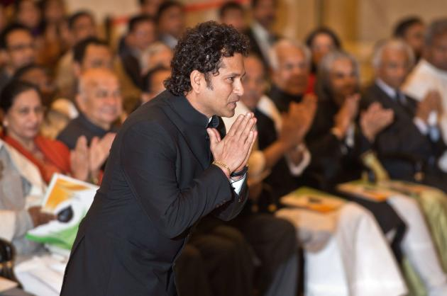 Retired cricketer Tendulkar greets Indian President Mukherjee before receiving the Bharat Ratna award from him in New Delhi
