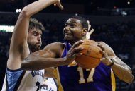 Memphis Grizzlies center Marc Gasol (33) defends Los Angeles Lakers center Andrew Bynum (17) in the first half of an NBA basketball game Tuesday, March 13, 2012, in Memphis, Tenn. (AP Photo/Alan Spearman)