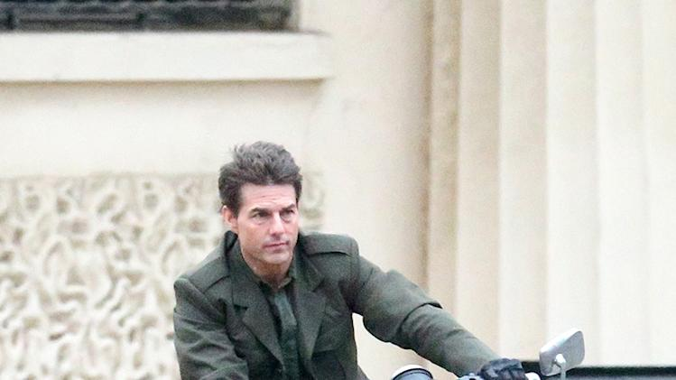 Tom Cruise rides a motorbike down The Mall without a crash helmet, London, UK