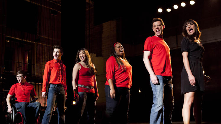 "In this undated image released by Fox, cast members, from left, Kevin McHale, Chris Colfer, Jenna Ushkowitz, Amber Riley, Cory Monteith and Lea Michele perform during a scene from ""Glee."" Monteith, who shot to fame in the hit TV series ""Glee"" but was beset by addiction struggles so fierce that he once said he was lucky to be alive, was found dead in a Vancouver hotel room, police said. He was 31. (AP Photo/Fox, Adam Rose)"