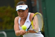 China's Peng Shuai plays a shot during her second round women's singles match against Japan's Ayumi Morita on day three of the 2012 Wimbledon Championships tennis tournament at the All England Tennis Club in Wimbledon, southwest London. Peng won the match