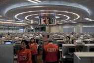 "Traders walk the floor of the Hong Kong Stock Exchange on March 7. Hong Kong's new stock exchange chief vowed Tuesday to provide an ""orderly and fair"" trading platform, amid concern about low quality listings in the world's biggest IPO market"
