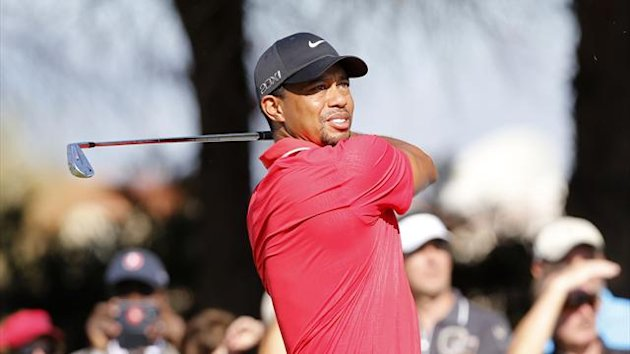 Tiger Woods of the US tees off on the 5th hole during the final round of the inaugural Turkish Airlines Open in the south west city of Antalya November 10, 2013.
