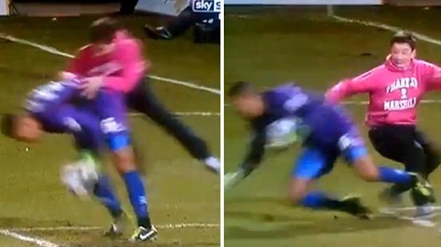 Wycombe goalkeeper Jordan Archer attacked by fan (Picture from Sky Sports)